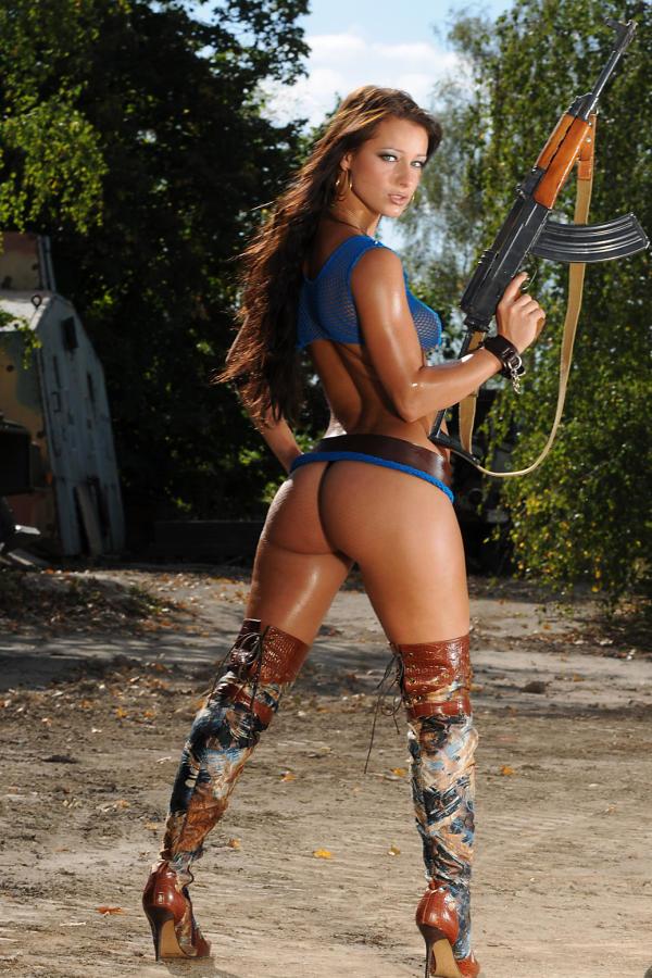 Cyber Angel Kristina posing with gun